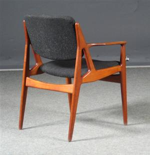 "Teak arm chairs designed by Arne Vodder (model ""Lene"")."